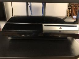 Playstation 3 with 8 original games image 3